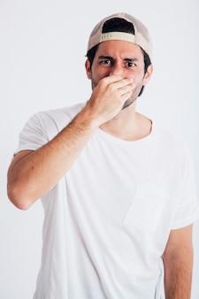 Man smelling something