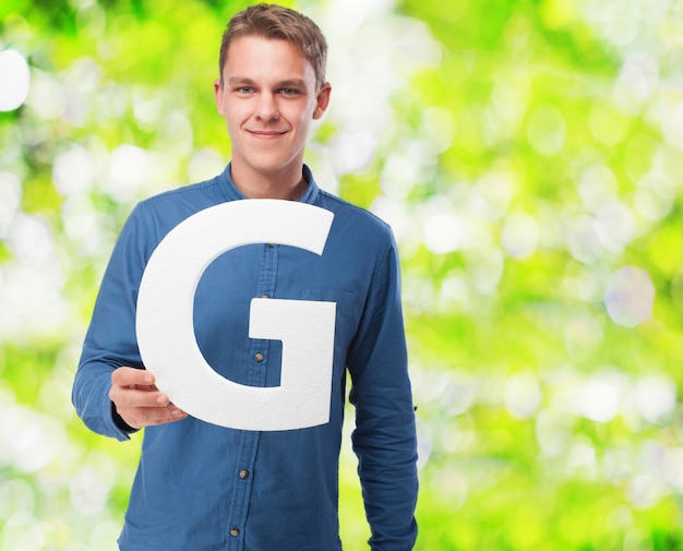 Man smiling holding the letter