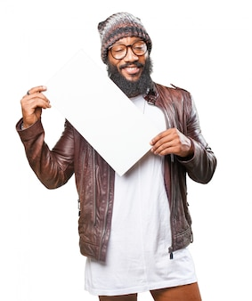 Man smiling holding a white sign