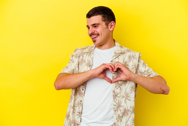 Man smiling and showing a heart shape with hands