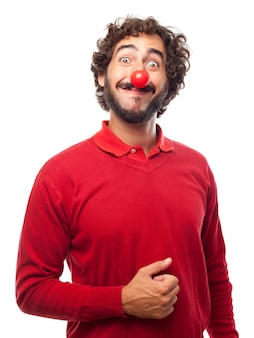 Man smiling with a fake red nose