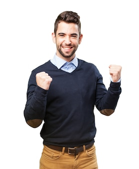 Man smiling with fists raised