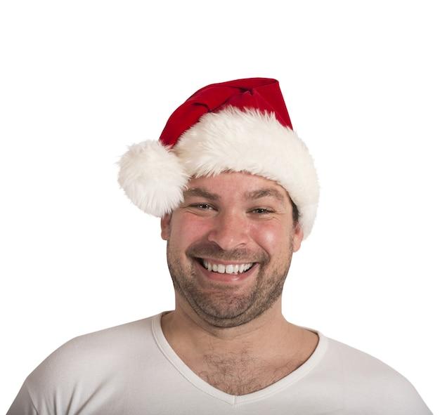 サンタクロースの帽子と笑顔の男