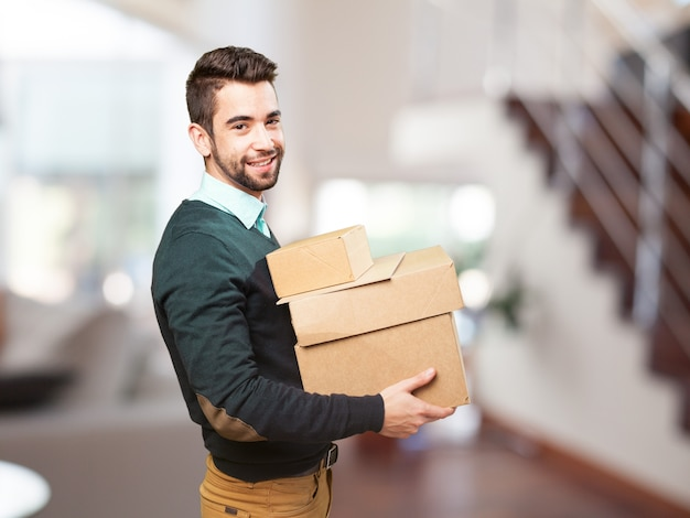 Man smiling with a lot of boxes