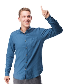 Man smiling with a raised finger