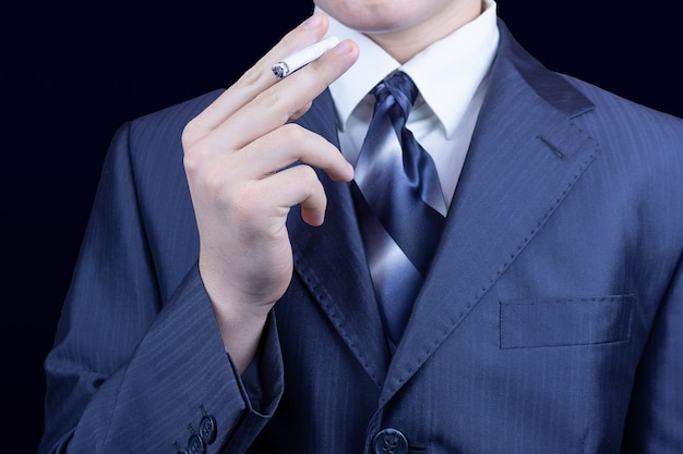 Man smoking cigarette blue background