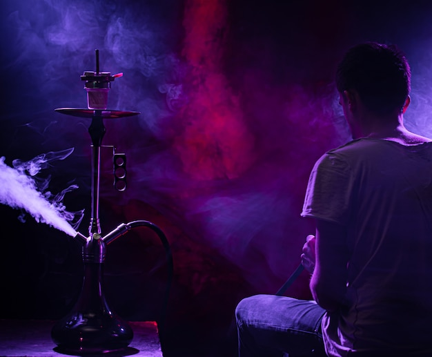 The man smoking the classic shisha.
