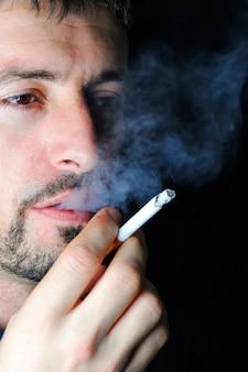 Man smoking in dark
