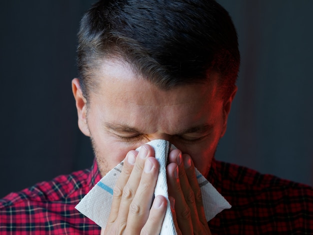 Man sneezing use a napkin. precaution and prevention ways to stop the pandemic virus from spreading.