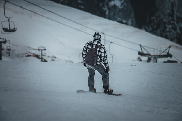 Man snowboarder rides on the slope. ski resort. space for text