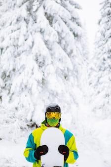 Man snowboarder in ski equipment copy space