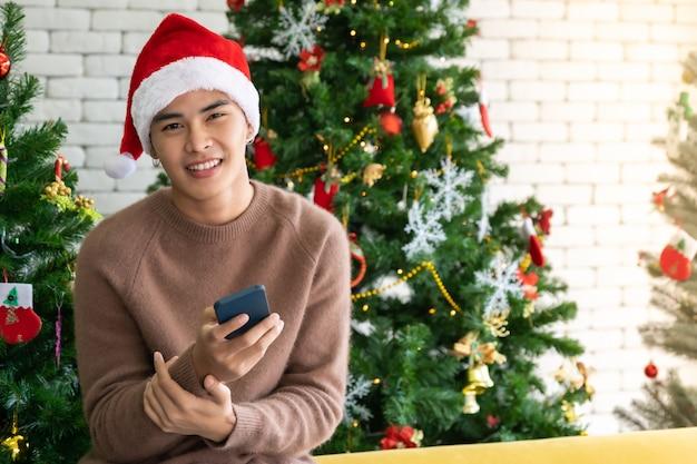 Man social media with christmas decoration