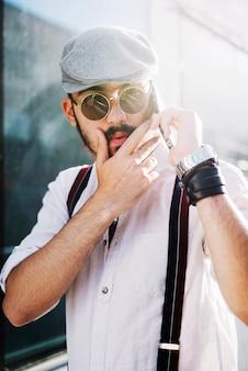 Man speaking on phone and touching beard