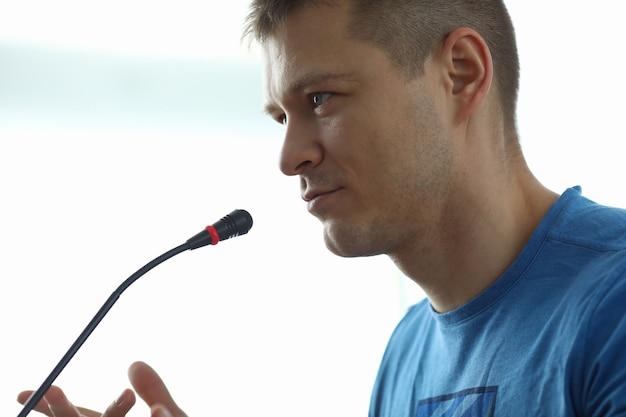 Man speaks in front microphone informal meeting portrait