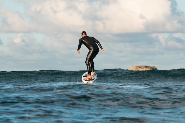 Man in special equipment surfing in hawaii