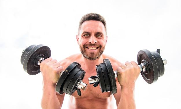 強い腹筋を持つ男のスポーツマン。ステロイド。アスレチックボディ。ダンベルジム。バーベルで運動する筋肉の男。スポーツ用品。完璧なボディ。フィットネス健康ダイエット。痛みなくして得るものなし。幸せなスポーツマン。