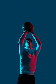 Man in sportswear playing basketball