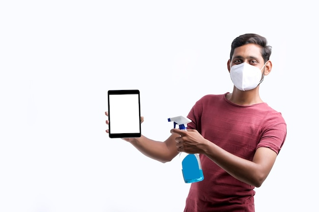 Man spraying alcohol,disinfectant spray on mobile phone,prevent infection of covid-19 virus,contamination of germs or bacteria,wipe or cleaning phone to eliminate,outbreak of coronavirus