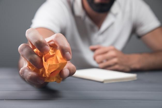 Man squeezes paper. concept idea