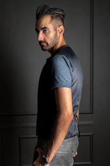 Man standing over dark wall