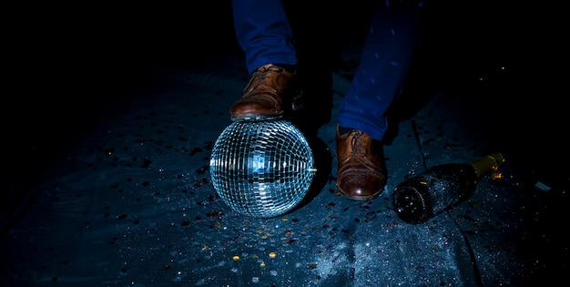 Man standing on floor with disco ball