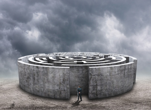 Man standing in front of the circular labyrinth