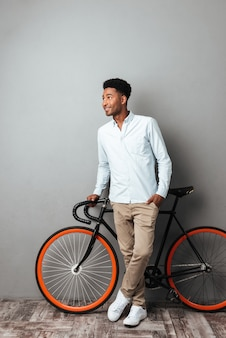 Man standing near bicycle isolated