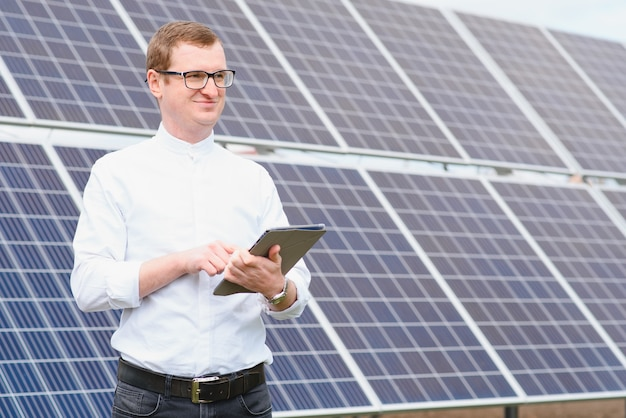 Man standing near solar panels