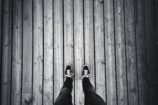 Man standing on the old wooden floor.