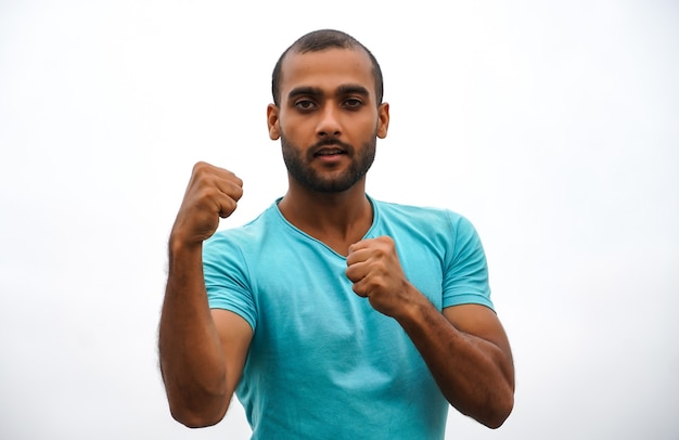 A man standing and showing punch