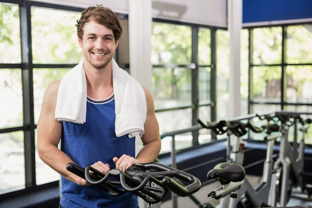 Man standing in spinning class