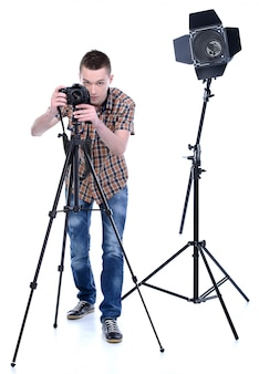 A man stands behind the camera