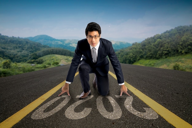 Man start to run on road with 2020