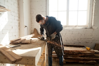 Man starting own small business in home workshop
