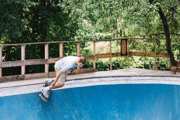 Man starting riding on skateboard
