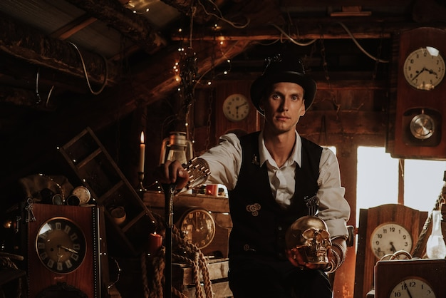 Man in a steampunk suit with a cane and a top hat with a golden skull