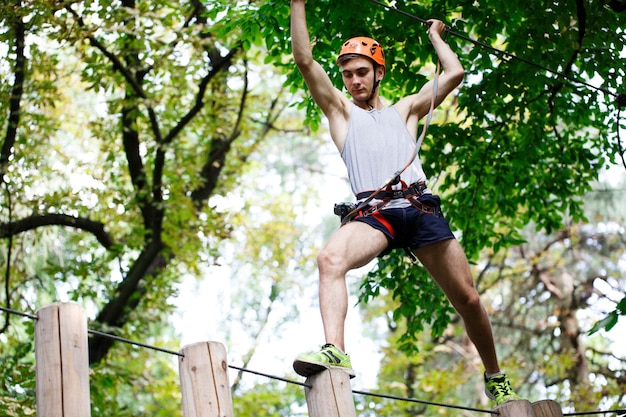 Man steps on the wooden blocks hanging in the air