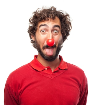 Man sticking out his tongue with a red nose
