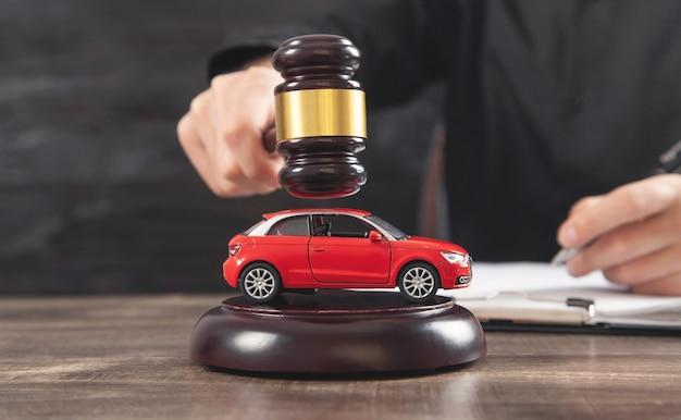 Man striking the gavel over car. car auction