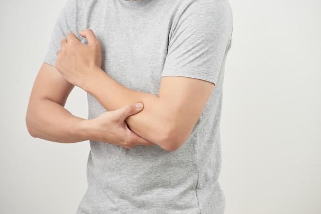 Man suffering from joint pain, arm bone pain, arthritis, gout, rheumatoid symptoms, radioactive sickness; sick man, ill man concept of male osteoporosis, injured bone, injury, pain, arthritis, gout