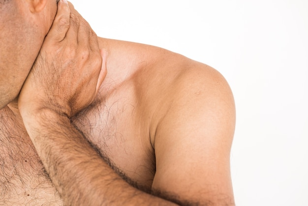 Man suffering from neck pain and injury on white background