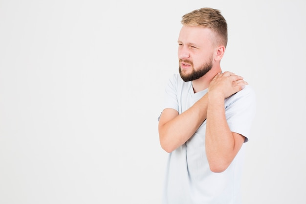 Man suffering from pain in shoulder