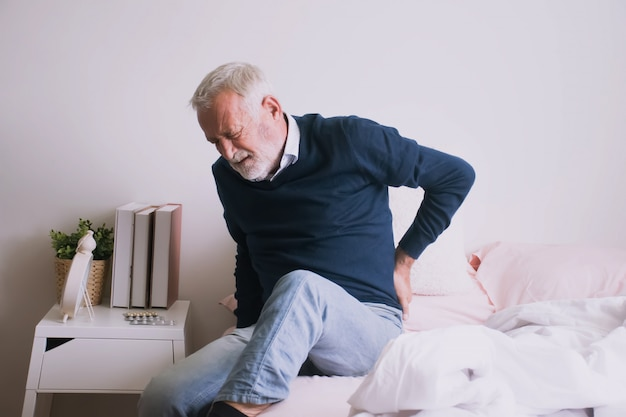 Man suffering from ribbing pain or waist pain.