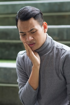 Man suffering from toothache, tooth decay, sensitivity, oral problem