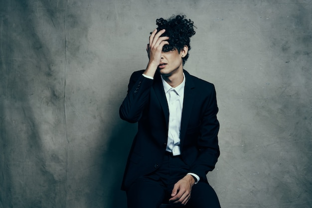 Man in suit curly hair modern lifestyle fashion