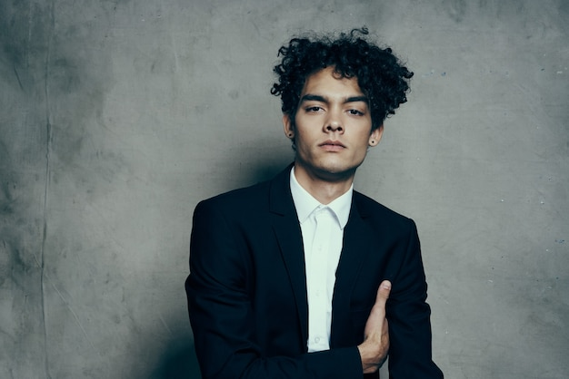 Man in suit and curly hair self confidence jacket fashion