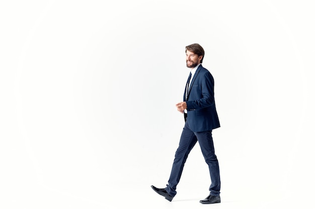 Man in a suit emotions successful light background