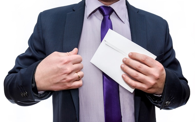 Man in suit hiding envelope into pocket