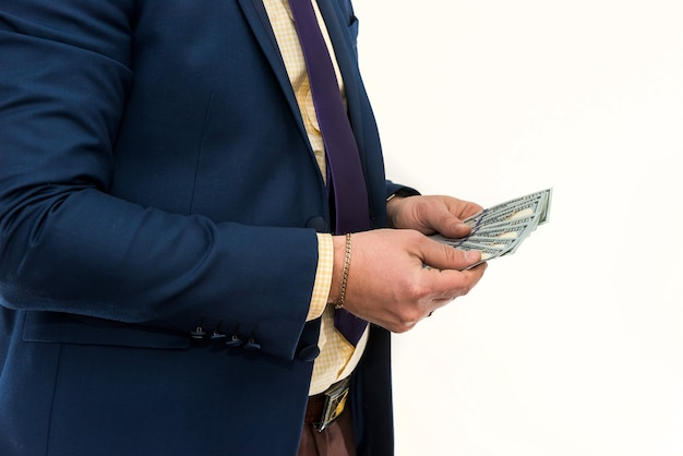 Man in suit hold many us money dollar, isolated on white. busimess or finance concept. saving