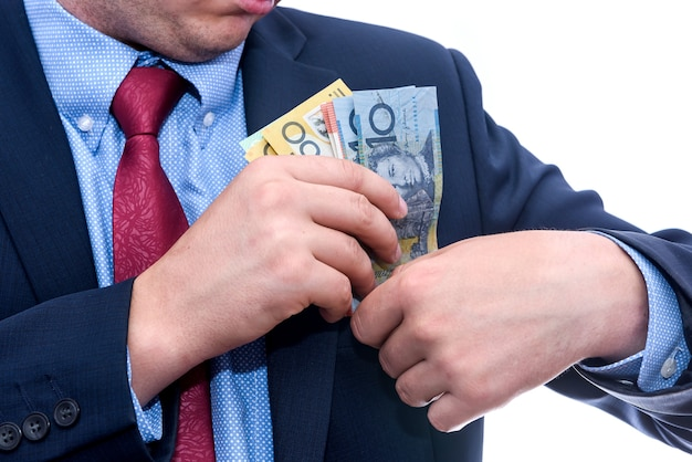 Man in suit holding australian dollar banknotes close up